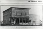 Titre original :  Courtesy Saskatoon Public Library. Half-tone (screened) image of J.F. Cairns Grocery Store at 2nd Avenue and 21st Street. This view show front and (North) side view of the frame building, which had a glass store front on the main floor. [ca. 1903]