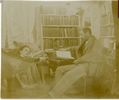 Original title:  Image courtesy of Esther Clark Wright Archives, Vaughan Memorial Library, Acadia University, Wolfville, Nova Scotia.  Photograph of John Frederic reading and Minnie lying in a hammock, in their library. Date Created: [1900?].