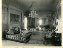 Original title:  Image from Hamilton Public Library, Local History and Archives. Wesanford, drawing room, after 1917. On the left of the hall is the drawing room, a vision of ivory and gold in Louis XIV style. It is a large room, about 40x25 feet, with a high ceiling that sets off the pretty scheme of decoration to advantage. The walls are of ivory enamel picked out with gold leaf with delicate rose pink satin panels woven in delicately intricate designs. Along the upper edge are jolly little Cupids engaged in the pretty vagaries that seem to constitute their mission in life. The mantel is composed of large slabs of Mexican onyx... The woodwork of the furniture is white and gold, upholstered in brown and gold. One of the largest make of Steinway pianos stands on one side.  Hamilton Spectator, June 8, 1892.