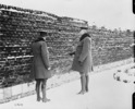 Titre original :  Gen. Currie visits Cemetery in Andenne where 200 civilians were shot by Germans against a wall, 21st. August 1918.