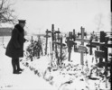 Titre original :  Gen. Currie visits Cemetery in Andenne where 200 civilians were shot by Germans against a wall, 21st August 1918.