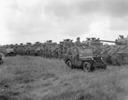 Titre original :  Tank crews of The British Columbia Dragoons lined up in front of their Sherman tanks during a review by General H.D.G. Crerar followed by a mounted marchpast, Eelde, Netherlands, 23 May 1945.