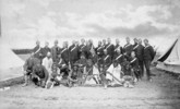 Original title:  Chief Piayot (ca. 1816-1908), Chief Cree and leader, and followers; Edgar Dewdney, Indian Commisioner for the North-West Territories; and members of the Montreal Garrison Artillery, Regina, Sask., May 1885.