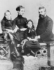 Original title:    Description Alexander Graham Bell with his wife Mabel Gardiner Hubbard and their children Elsie May Bell (far left) and Marian Hubbard Bell. Date circa 1885(1885) Source   This image is available from the United States Library of Congress's Prints and Photographs division under the digital ID ppmsc.00856. This tag does not indicate the copyright status of the attached work. A normal copyright tag is still required. See Commons:Licensing for more information. العربية | Česky | Deutsch | English | Español | فارسی | Suomi | Français | Magyar | Italiano | Македонски | മലയാളം | Nederlands | Polski | Português | Русский | Slovenčina | Türkçe | 中文 | ‪中文(简体)‬ | +/− Author Not listed; part of the LOC's Gilbert H. Grosvenor Collection of Photographs of the Alexander Graham Bell Family.