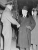 Original title:    Description George Beurling, Canadian WWII ace, shaking hands with William Lyon Mackenzie King. Date November 1942(1942-11) Source This image is available from Library and Archives Canada under the reproduction reference number C-000025 and under the MIKAN ID number 3644108 This tag does not indicate the copyright status of the attached work. A normal copyright tag is still required. See Commons:Licensing for more information. Library and Archives Canada does not allow free use of its copyrighted works. See Category:Images from Library and Archives Canada. Author Unknown Permission (Reusing this file) PD-Canada