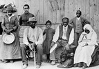 "Titre original :    Description Harriet Tubman (c. 1820 – March 10, 1913), far left, with slaves she helped rescue, during the American Civil War. Left to right: Harriet Tubman; Gertie Davis   (adopted daughter of Tubman} behind Tubman; Nelson Davis (husband and 8th USCT veteran); Lee Cheney (great-great-niece); ""Pop""   Alexander; Walter Green; Blind ""Aunty"" Sarah Parker; Dora Stewart (great-niece and granddaughter of Tubman's brother Robert Ross aka John Stewart). [Note: Dora Stewart is sometimes cropped out of other versions of this photograph] Source: Kate Clifford Larson Date Catherine Clinton (2004) gives the date as c. 1885 Source Bettman/Corbis, through The New York Times photo archive, via their online store, here Author Not given Permission (Reusing this file) Public Domain"