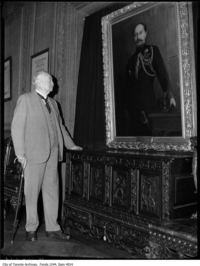 Original title:  Sir Henry Pellatt views his own portrait at Casa Loma. [ca. 1930]. City of Toronto Archives, Fonds 1244, Item 4014, William James family fonds.