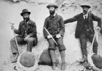 Original title:  Sir James Outram (at centre) and Swiss guides, near Banff, Alberta. After the first ascent of Mount Assiniboine. L-R: Christian Hasler, James Outram, Christian Bohren. Date: 1901. Image courtesy of Glenbow Museum, Calgary, Alberta.