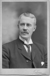 Original title:  Black and white portrait of C.B. (Clarence Bartlett) Edwards. Taken by Frank Cooper, photographer, c. 1903.  Source: Ivey Family London Room, London Public Library, London, Ontario, Canada (http://images.ourontario.ca/london/74422/data).