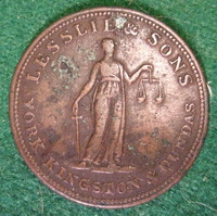 "Original title:    Description Lesslie and Sons business token from 19th Century Ontario Canada. Date 7 March 2009, 02:48 Source CANADA, ONTARIO, YORK KINGSTON and DUNDAS 19th C. LESSLIE and SONS HALFPENNY TOKEN b Author Jerry ""Woody"" from Edmonton, Canada"