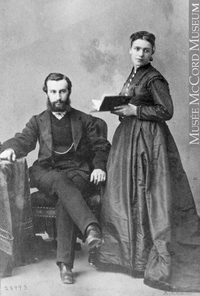 Original title:  Photograph Mr. and Mrs. J. Breakey, Montreal, QC, 1867 William Notman (1826-1891) 1867, 19th century Silver salts on paper mounted on paper - Albumen process 8.5 x 5.6 cm Purchase from Associated Screen News Ltd. I-28993.1 © McCord Museum Keywords:  couple (556) , Photograph (77678) , portrait (53878)