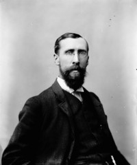 Titre original :  Hon. George Eulas Foster, M.P. (King's, N.B.) (Minister of Finance) b. Sept. 3, 1847 - d. Dec. 30, 1931.