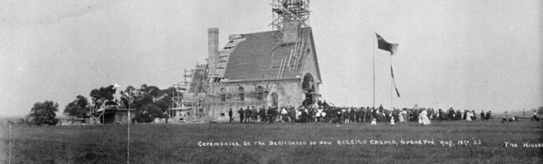"Original title:  MIKAN 3370467 Ceremonies at the Dedication of New Acadian Church, Grand Pré, N.S. The Historic ""Land of Evangeline"" showing the Beautiful Dominion Atlantic Railway Park. Aug. 16th 1922 [39 KB, 760 X 231]"